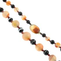 A banded agate necklace.Diameter of beads 0.6 to 1.5cms.
