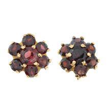 A pair of garnet floral cluster earrings.