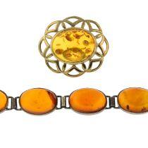 A modified amber brooch and bracelet.Bracelet stamped 925.Length of brooch 4cms.