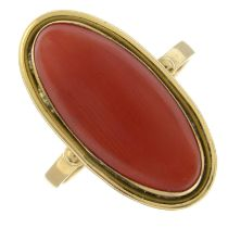 A coral single-stone ring.Stamped 750.Ring size O 1/2.