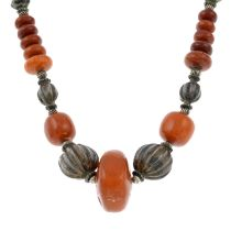 An amber and white metal bead necklace.Length 69cms.