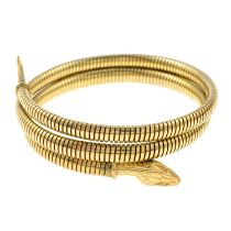 A mid 20th century rolled gold engraved snake bangle.Stamped rolled gold.