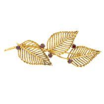 A garnet set leaf design brooch, by Zeeta.Signed Zeeta.