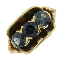 A synthetic spinel three stone ring.Stamped 585.Ring size N.