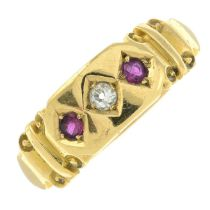 An early 20th century 18ct gold old-cut diamond and ruby three-stone ring.Ring size N1/2.