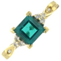 A synthetic emerald and diamond ring.Stamped 14K.