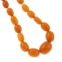 An amber and resin graduated bead necklace.Amber is untested.Diameter of beads 1.5 to 3.1cms.