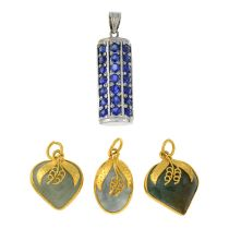 A sapphire set pendant and three jade pendants.Lengths 2 to 3.3cms.