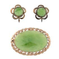 A jade brooch and a pair of jade earrings.