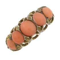A late Victorian 9ct gold coral five-stone ring.