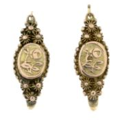 A pair of early 20th century cultured pearl earrings and a pair of filigree earrings.One stamped