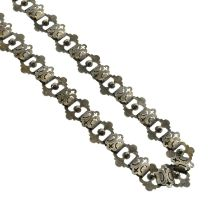A Victorian openwork-chain collar necklace.Length 43.5cms.