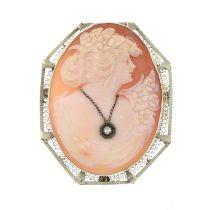 A diamond set cameo brooch.Stamped 14K.