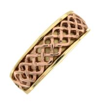 A 9ct gold Celtic knot band ring.Hallmarks for Sheffield.Ring size M.