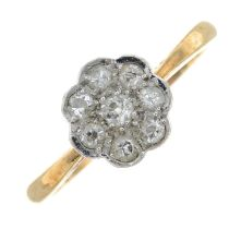 An old-cut diamond cluster ring.