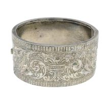 A late Victorian engraved hinge bangle.Inner diameter 5.7cms.