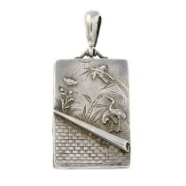 A late Victorian silver locket featuring a crane and parrot motif.Length 6cms.