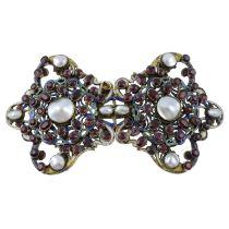 An Austro-Hungarian enamel, mabe pearl, garnet and vari-hue enamel buckle.AF.Length 11cms.