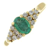 A 9ct gold emerald and diamond dress ring.Estimated total diamond weight 0.10ct.Import marks for