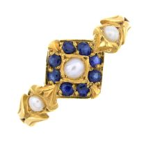 An early 20th century 18ct gold sapphire and split pearl ring.Stamped 18ct.Ring size P.