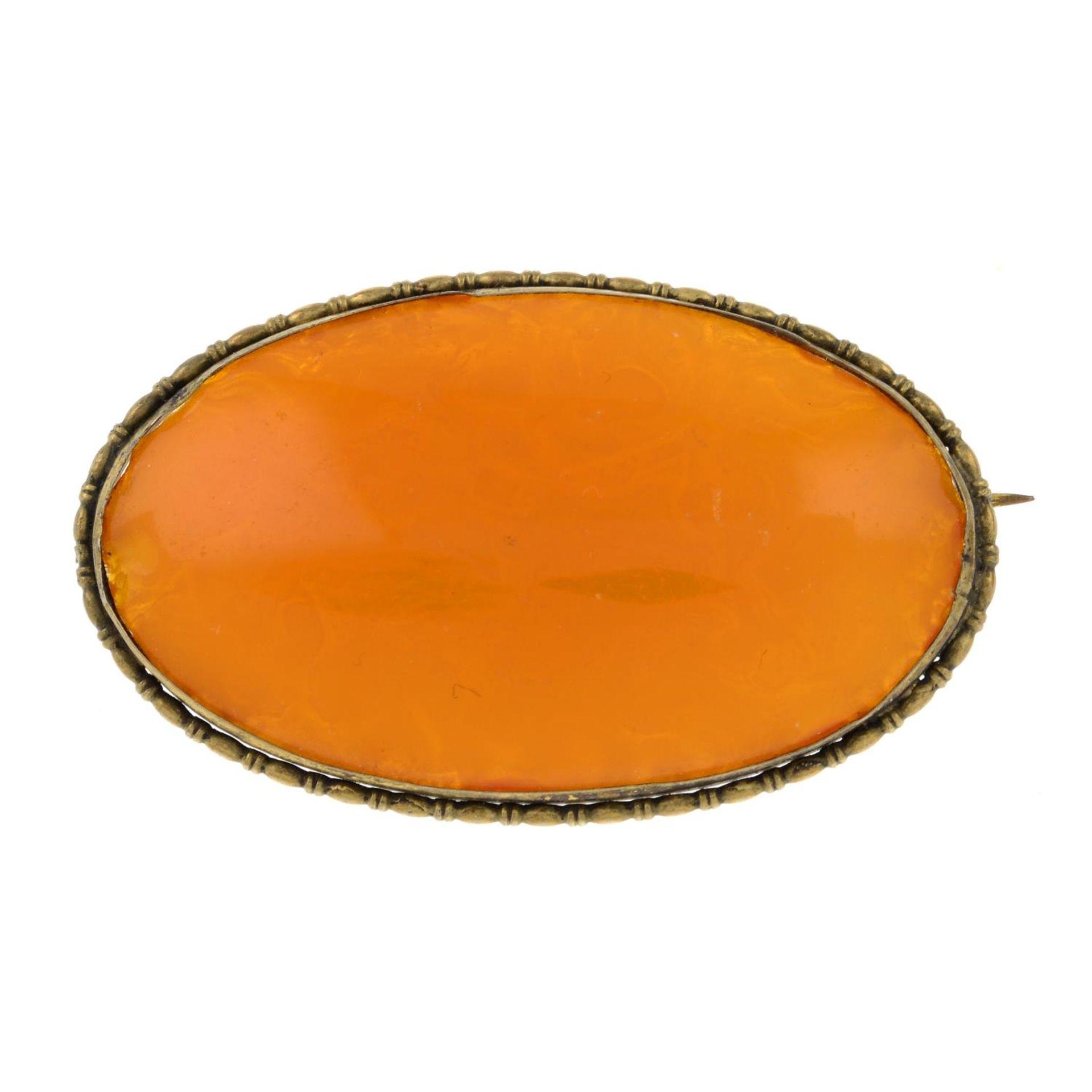 An amber brooch.Length 5.5cms.