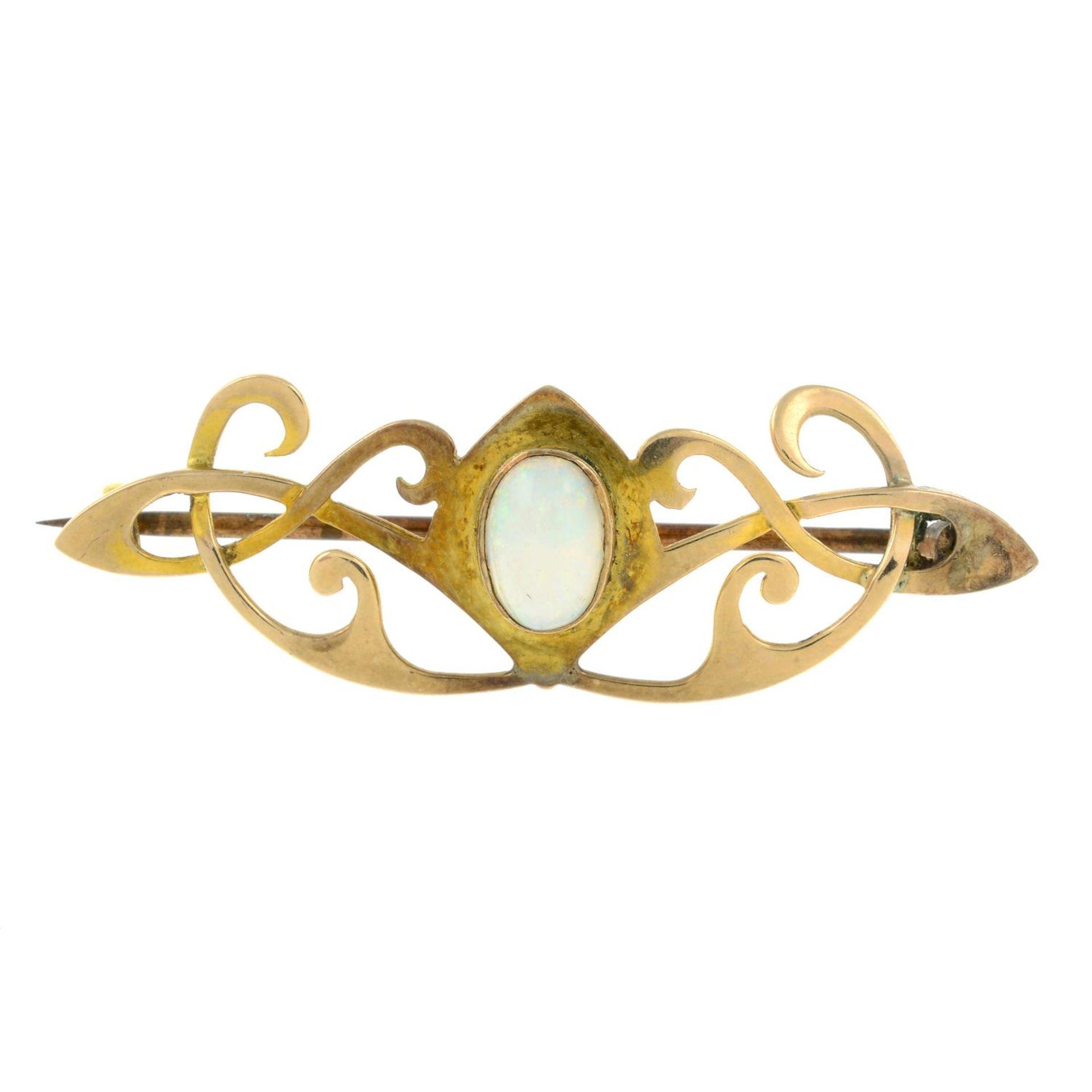 An Art Nouveau gold opal brooch.Length 4.4cms.