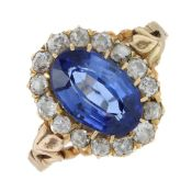 A synthetic sapphire and old-cut diamond cluster ring.Estimated total diamond weight 0.10ct.Stamped