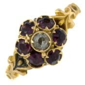 An early 20th century 15ct gold garnet and colourless paste cluster ring.Stamped 15.Ring size K.