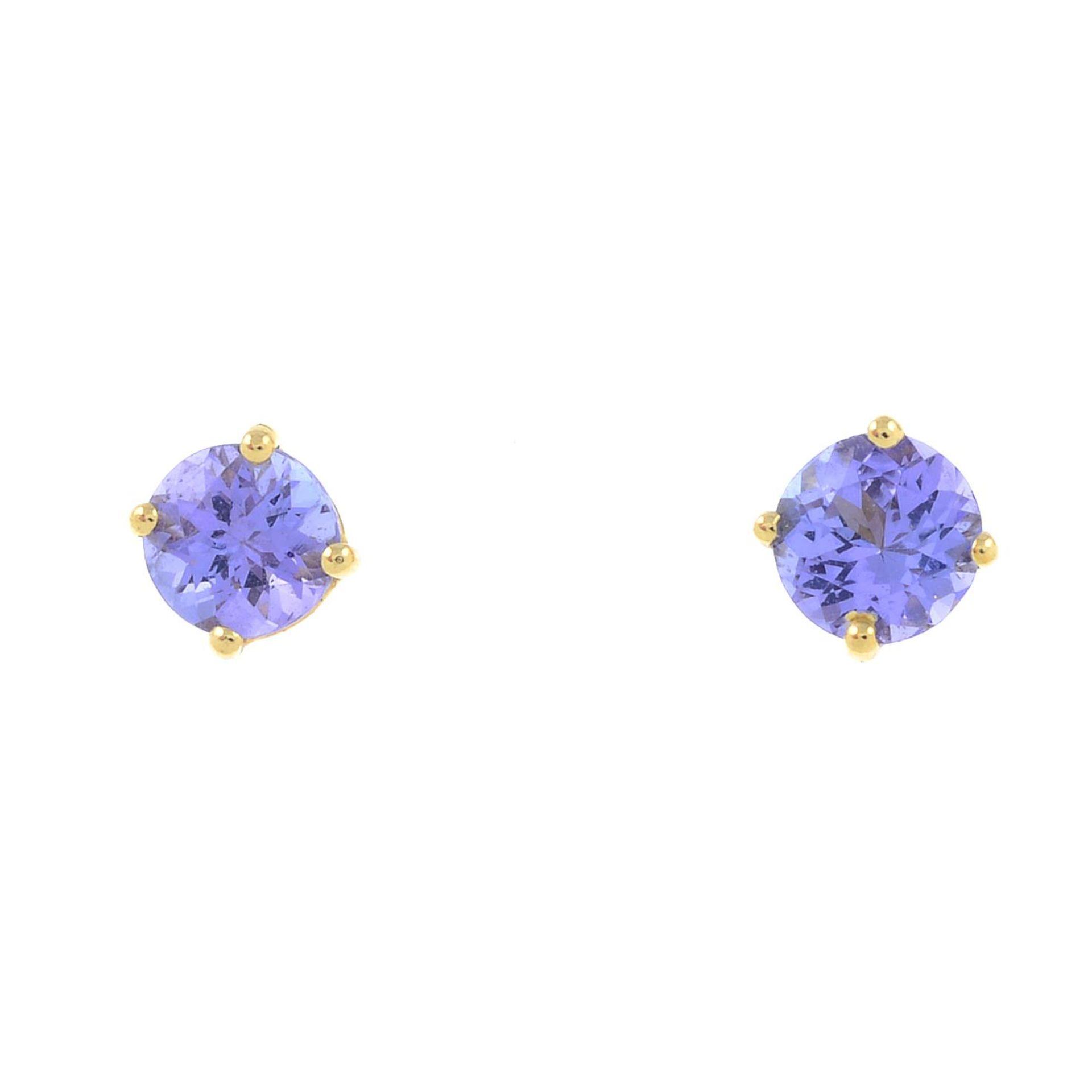 A pair of tanzanite stud earrings.Stamped 14K.Diameter 0.4cm.