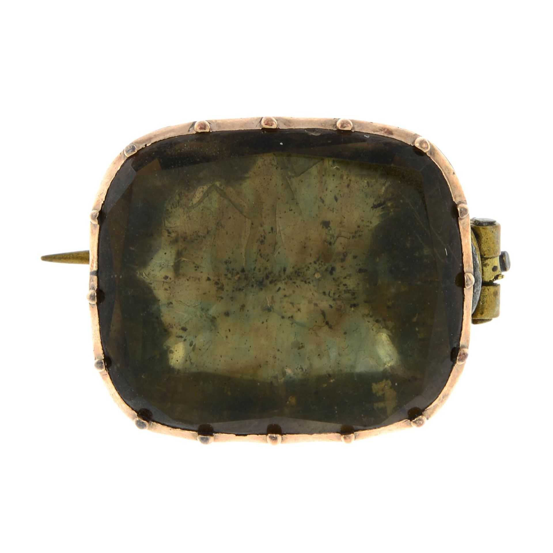 A mid 19th century gold foil-back quartz brooch.Length 2.2cms.