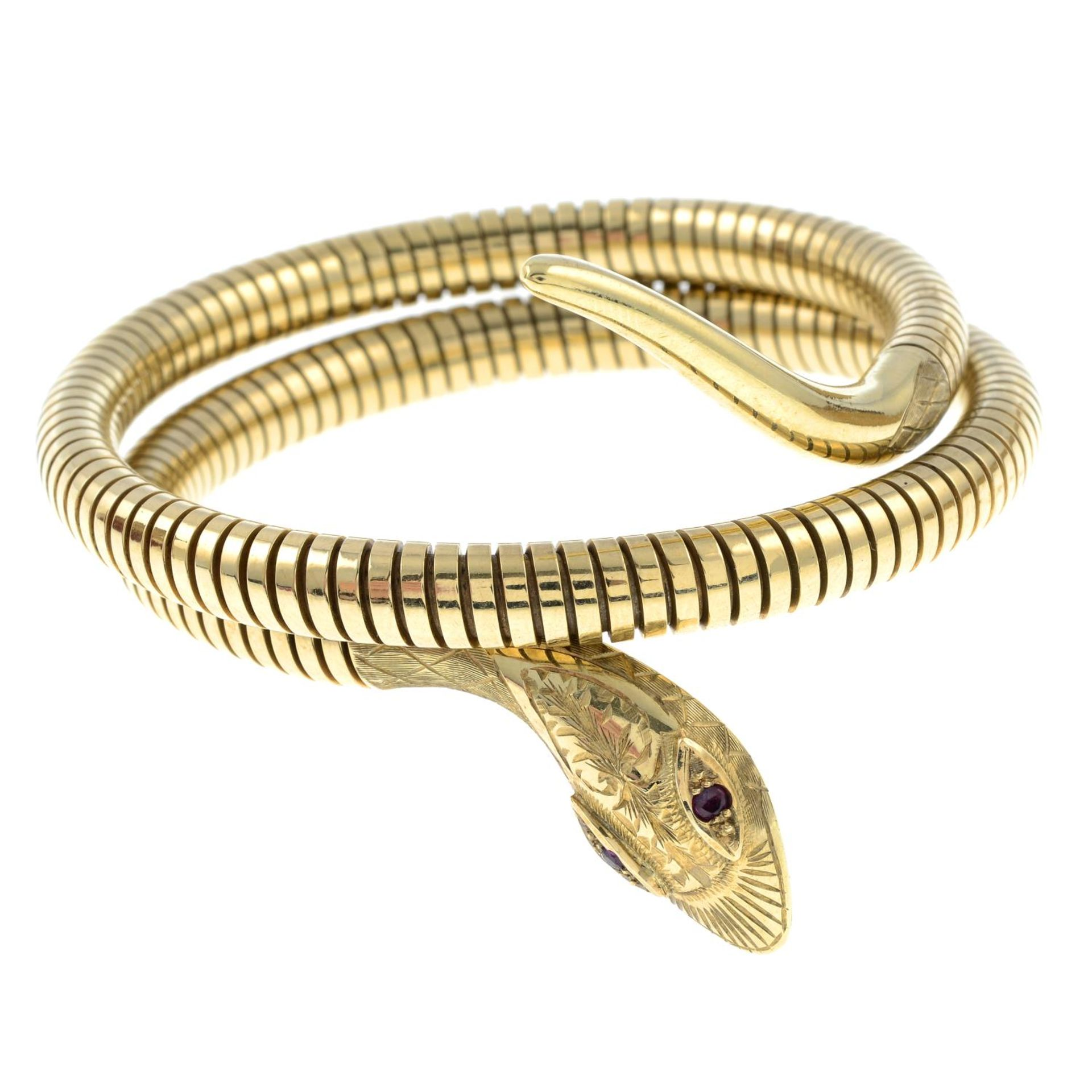 A 1950s 9ct gold coiled snake bangle,
