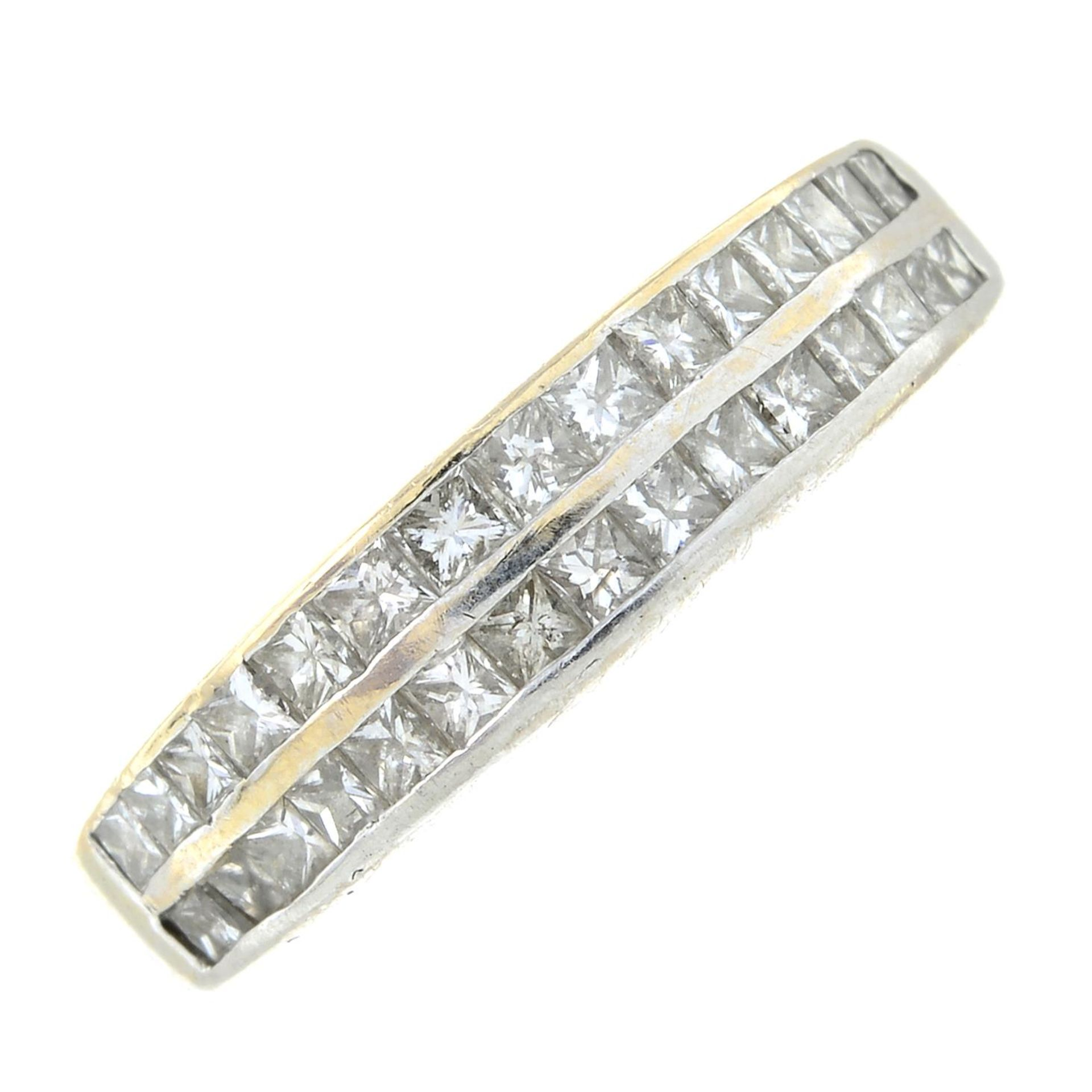 A brilliant-cut diamond two-row half eternity ring.Estimated total diamond weight 0.6c0t.