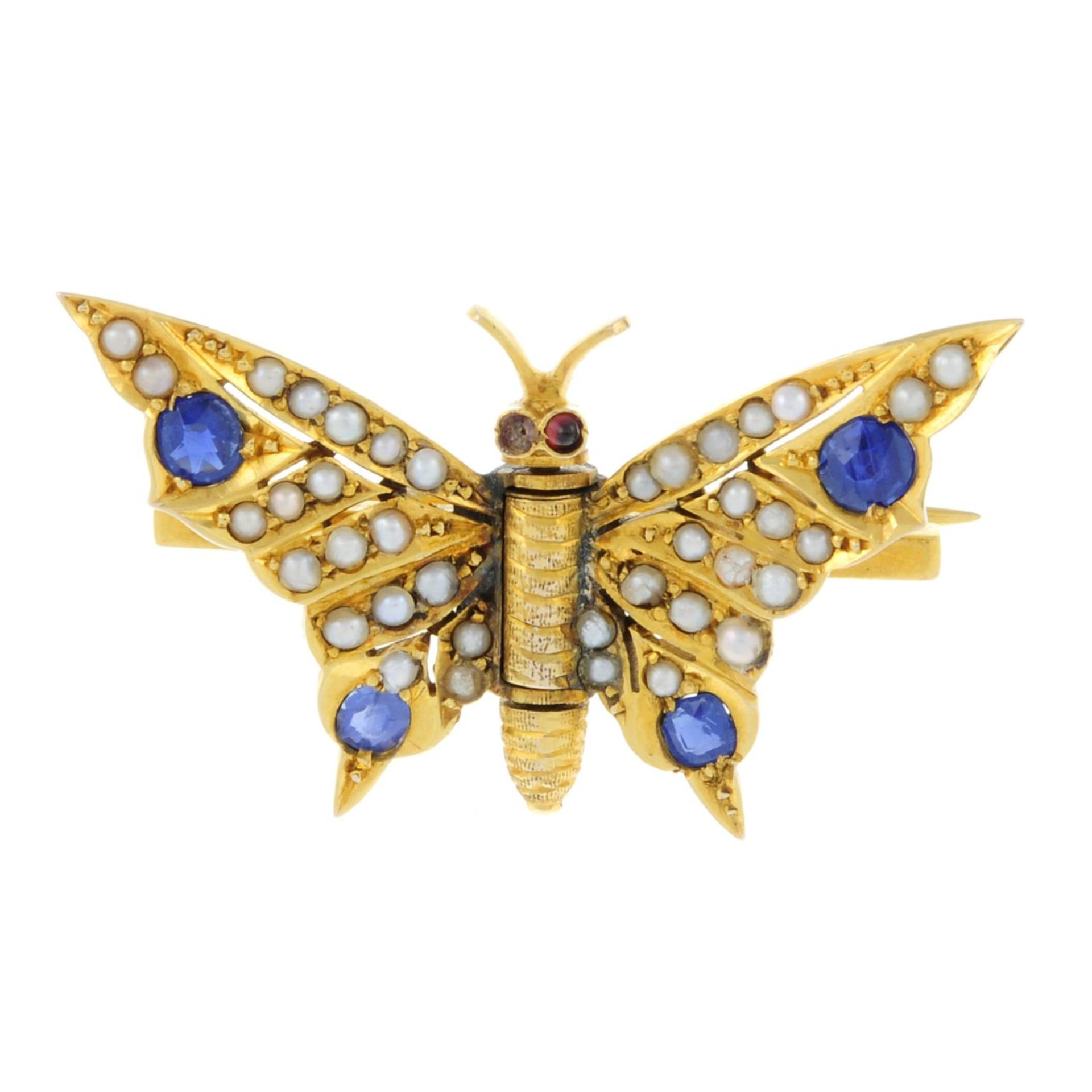 An early 20th century gold sapphire, split pearl and garnet butterfly brooch.Length 3.2cms.