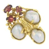 A mother-of-pearl and garnet cluster ring.