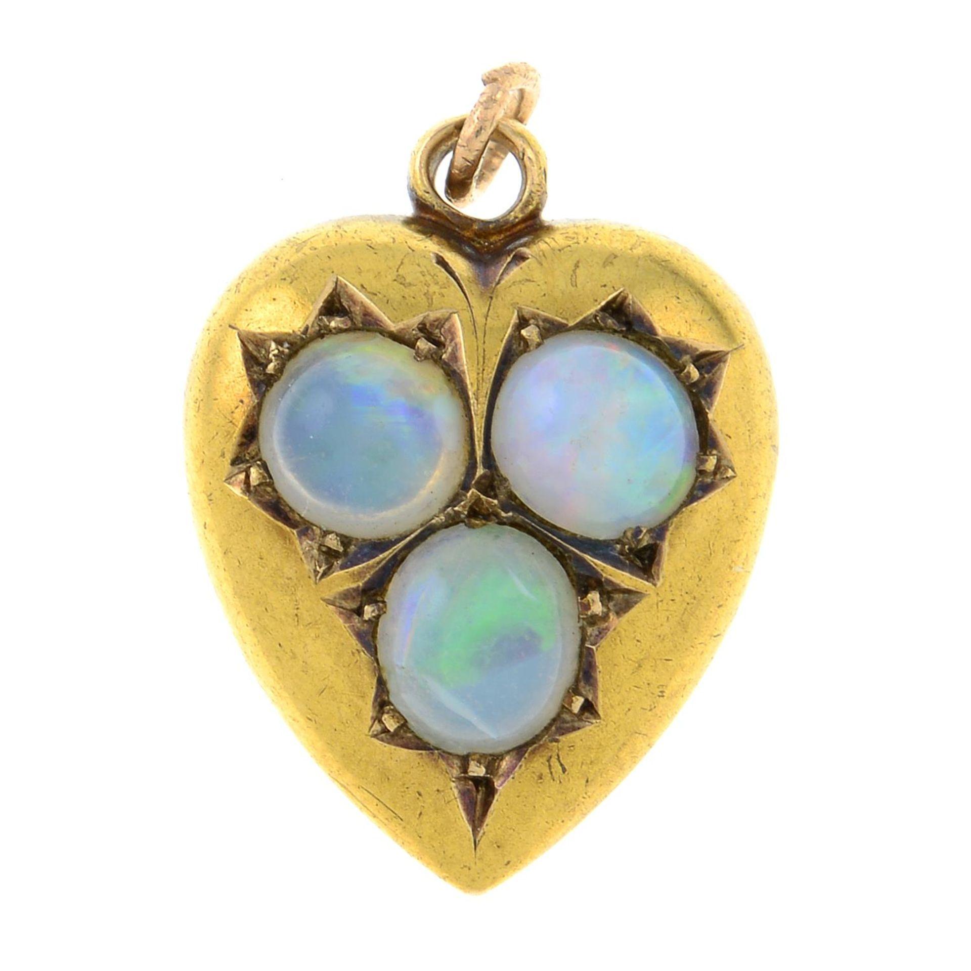 An Edwardian 15ct gold opal heart pendant.Hallmarks for Chester, 1905.