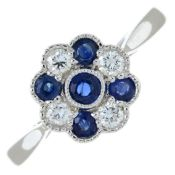 An 18ct gold sapphire and diamond dress ring.Total sapphire weight 0.41ct.