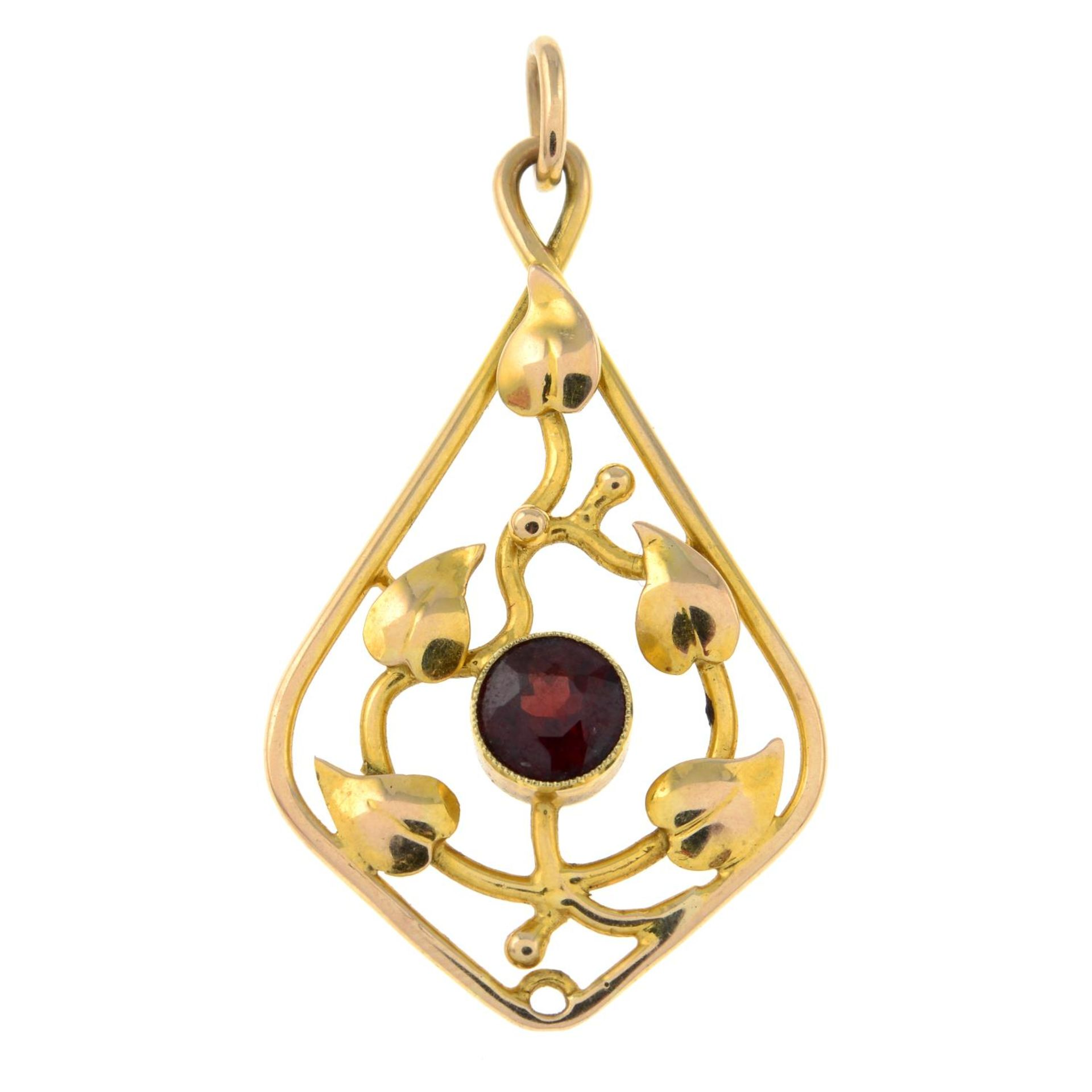 An early 20th century gold garnet foliate pendant.Length 4.6cms.
