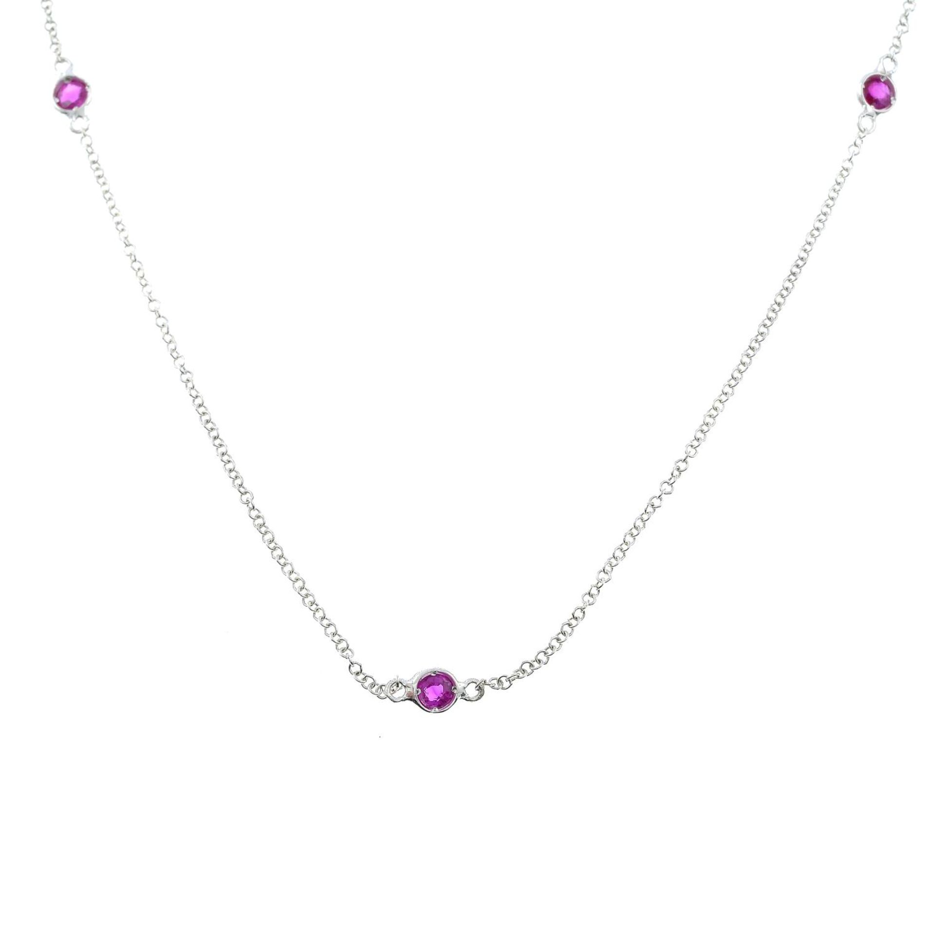 A necklace, with ruby spacers.
