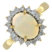 A 9ct gold opal and brilliant-cut diamond cluster ring.Estimated total diamond weight