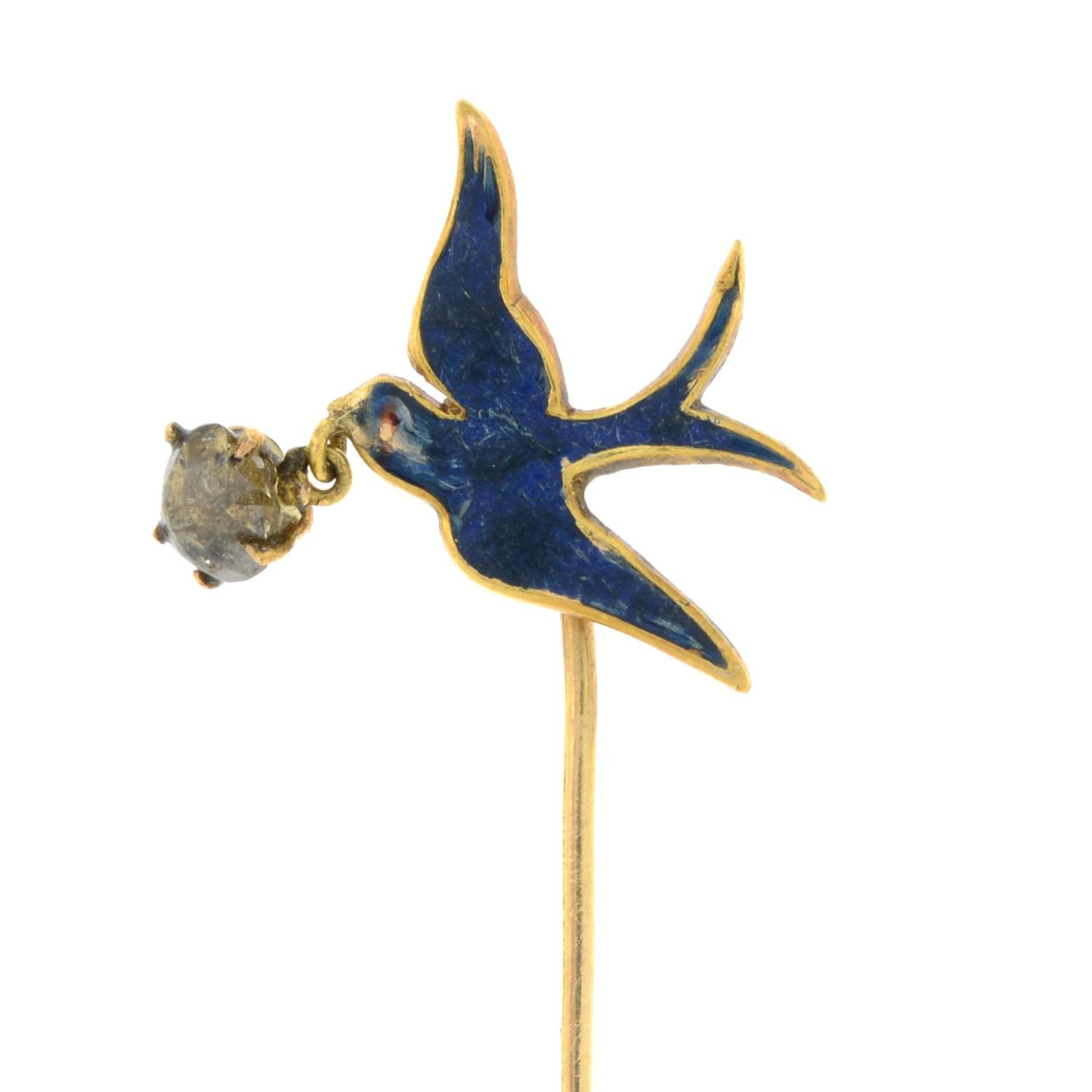 An early 20th century gold and blue enamel swallow stickpin,