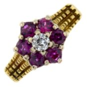A diamond and ruby floral cluster ring.Diamond estimated weight 0.15ct, H-I colour, VS clarity.