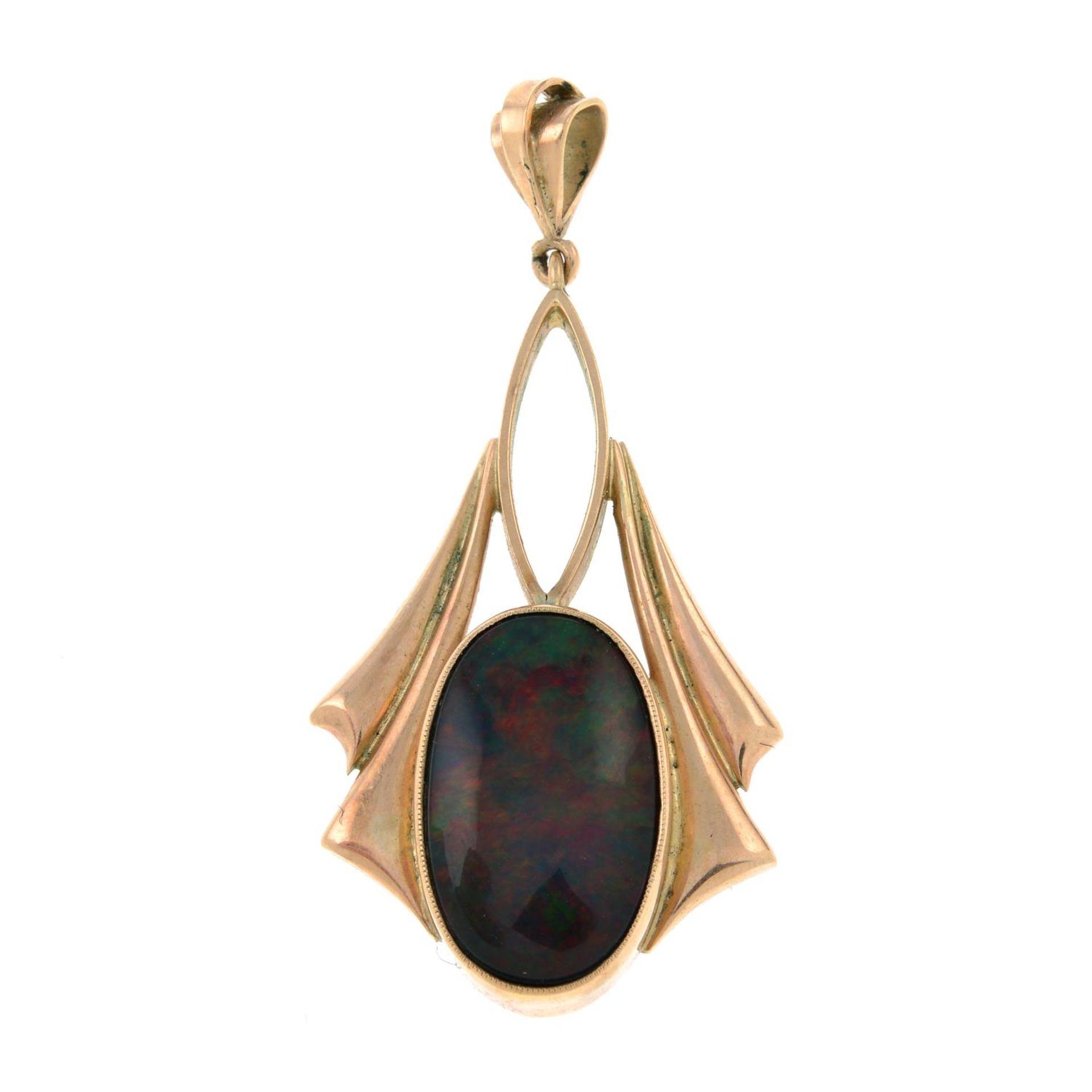 An early 20th century gold opal pendant.Length 3.7cms.