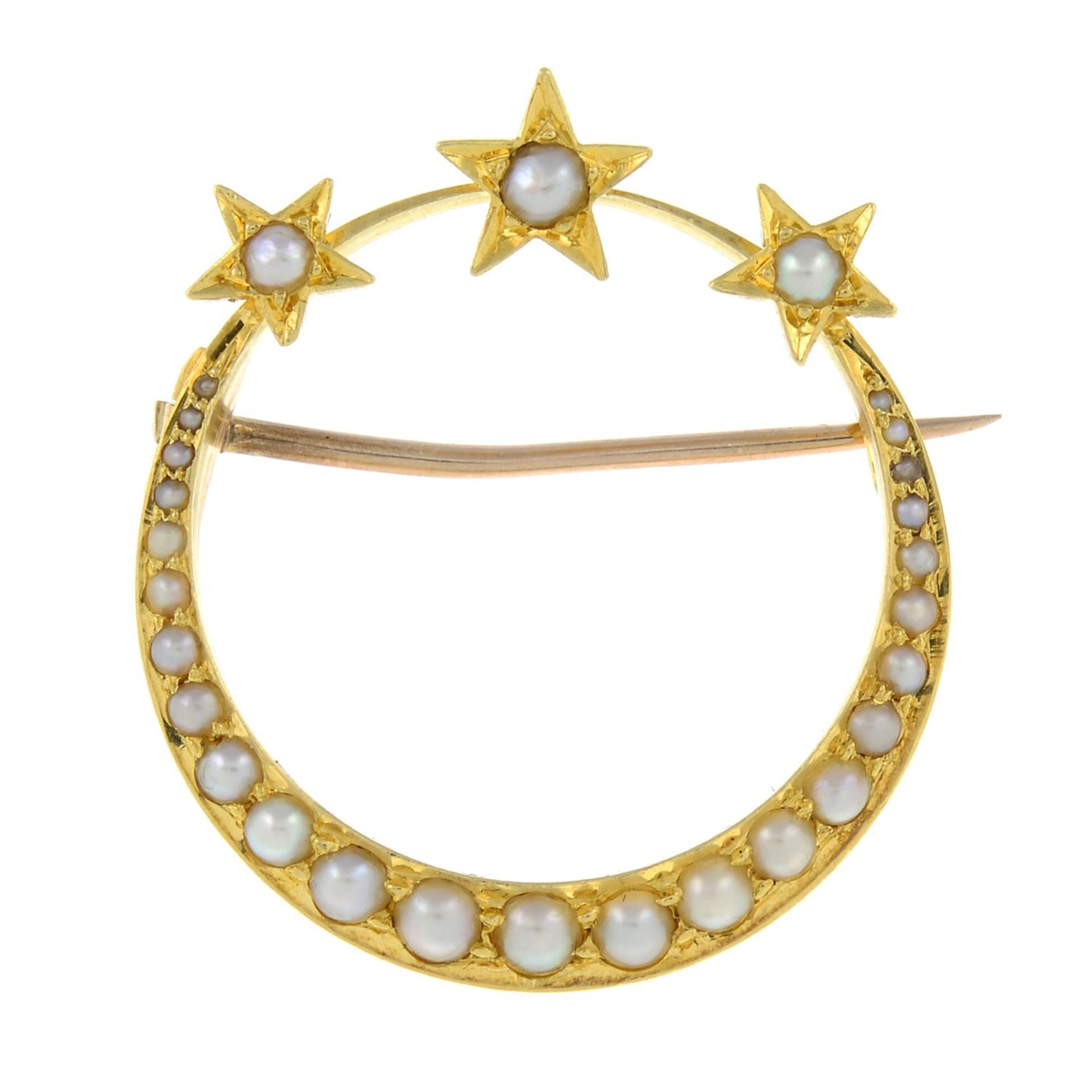 A late 19th century 15ct gold split pearl star and crescent brooch.Length 2.8cms.