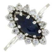 A sapphire and brilliant-cut diamond cluster ring.Estimated total diamond weight 0.40ct.Ring size