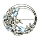 An Arts and Crafts silver aquamarine brooch, attributed to Bernard Instone.Diameter 4cms.