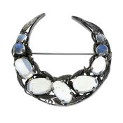 An Arts and Crafts silver moonstone crescent moon brooch,