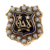 An American split pearl, diamond and enamel fraternity pin for Theta Delta Chi.Length 1.3cms.