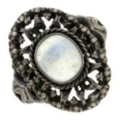 An Arts and Crafts silver moonstone single-stone ring, in the manner of Sybil Dunlop.Ring size N.