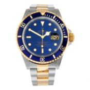 ROLEX - an Oyster Perpetual Date Submariner bracelet watch.