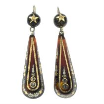 A pair of late 19th century tortoiseshell pique earrings.